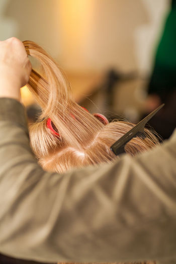 Close-up of woman holding hair home