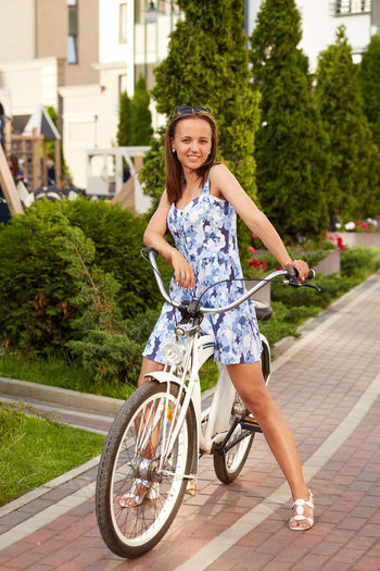Portrait of happy woman riding bicycle