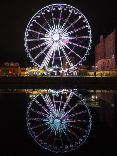 Gdansk (Danzig) Poland Polska Reflection Amusement Park Amusement Park Ride Architecture Arts Culture And Entertainment Building Exterior Circle City Ferris Wheel Gdansk Geometric Shape Illuminated Night Nightlife No People Outdoors Reflection Reflections Reflections In The Water Sky Travel Destinations Water