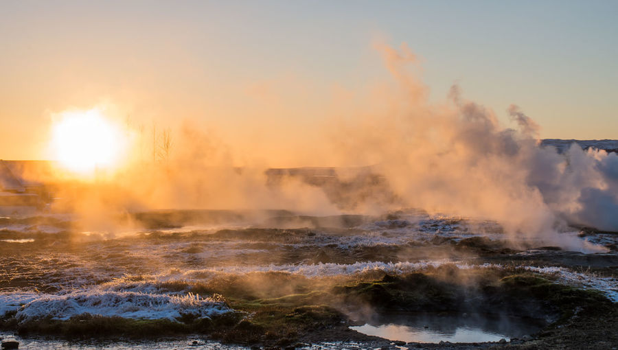 Geysir at Sunset at Strokkur, Iceland Geysir Hot Springs Geysir Strokkur Iceland Steam Strokkur Strokkur Geyser Sunset_collection Traveling Vapor Winter Destinations Erupting Eruption Geysir Golden Hour Goldenhourphotography Iceland_collection Idyllic Landscape Mist Sky Snow Sunset Travel Destinations Water