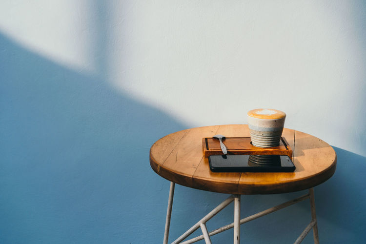 Coffee on table against wall