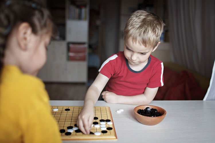 Boy playing with table at home
