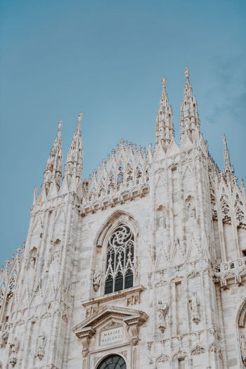 Low angle view of milan cathedral against clear sky
