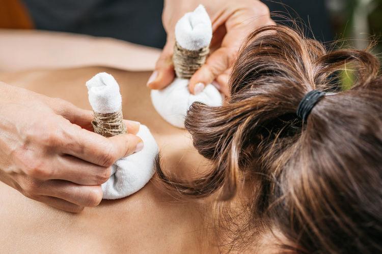 Potli dry massage therapy at ayurvedic wellness center.