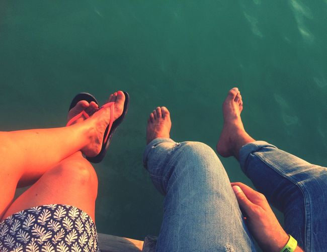 Water Nature Relaxation Outdoors Summer Road Tripping Human Leg Low Section barefoot Real People Human Body Part Togetherness Day Lake Leisure Activity Sitting Bonding Men Lifestyles Women Human Hand Friendship Close-up People