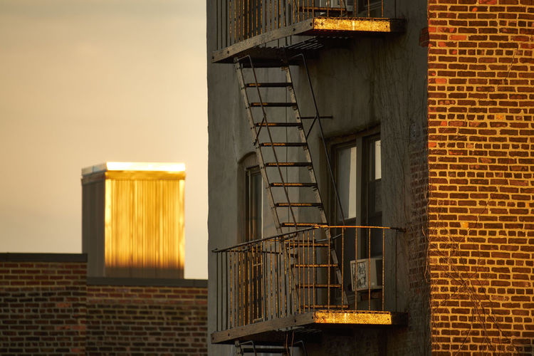 Ladder At Balcony Against Sky During Sunset