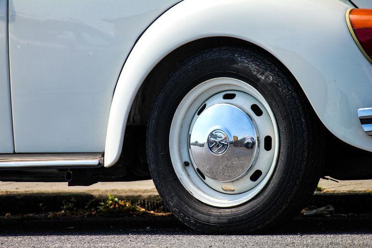Close-up of vintage car parked on street