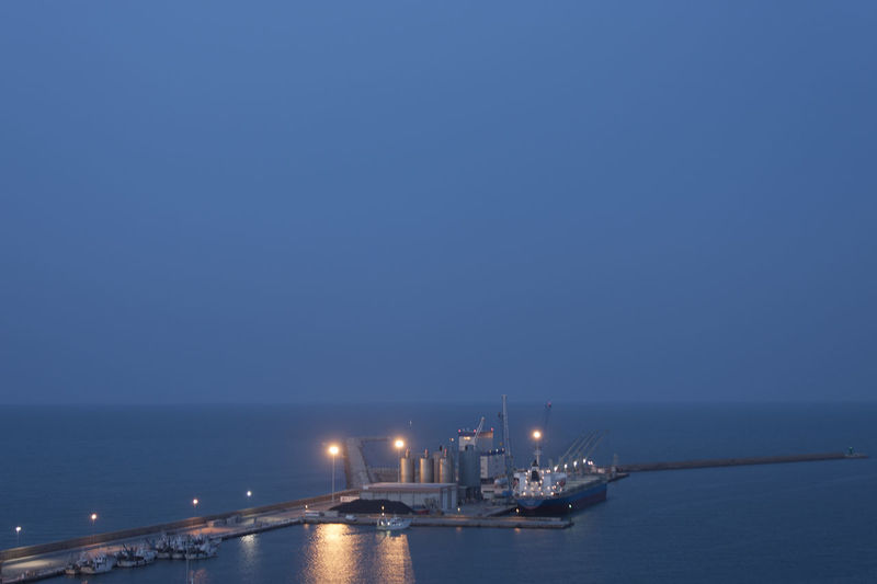 Marine port with boats at anchor at night