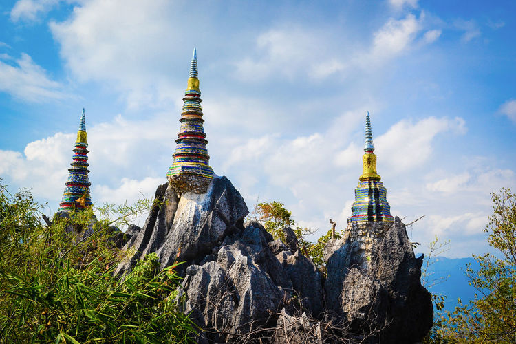 Three rock pagodas on the mountain Lampang Thailand Architecture Belief Blue Sky Buddhism Built Structure Cloud - Sky Nature No People Outdoors Pagoda Place Of Worship Religion Religion And Beliefs Religious  Sky Spirituality Three Travel Travel Destinations