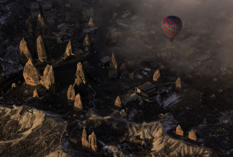 A hot air balloon rising up from the Cappadocia Valley, Turkey Valley View Cappadocia Hot Air Ballons Cappadocia Low Clouds Hot Air Balloons Göreme Kapadokya Turkey Attractions Turkey Türkiye Travel Destinations Vacation Attraction Adrenaline Background Balloon Hot Air Balloon Transportation Air Vehicle Flying Nature Burning Outdoors Mid-air No People