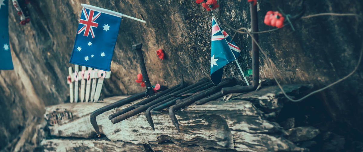 Close-up of damaged flag on wall
