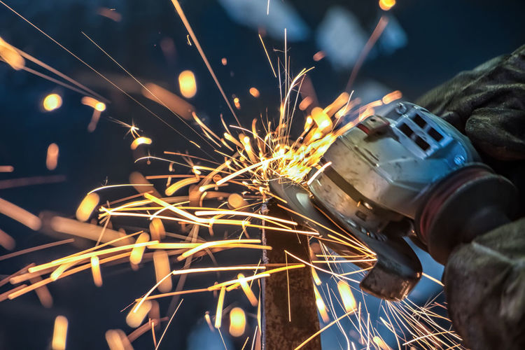 Blurred Motion Burning Close-up Factory Flame Focus On Foreground Glowing Heat - Temperature Human Hand Illuminated Indoors  Industry Long Exposure Manufacturing Equipment Metal Metal Industry Motion Night Occupation One Person Real People Sparks Welder Welding