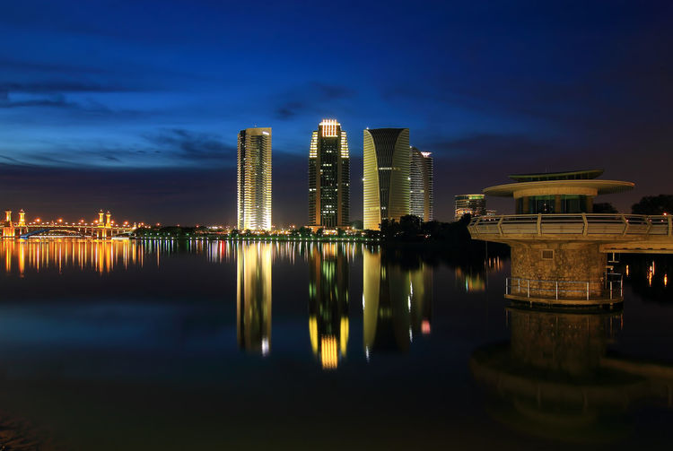 Sunset at Putrajaya, Malaysia with a blue hour Blue Hour Architecture Building Building Exterior Built Structure City Cityscape Financial District  Illuminated Malaysia Modern Nature Night No People Office Building Exterior Outdoors Putrajaya Reflection River Sky Skyscraper Tall - High Urban Skyline Water Waterfront
