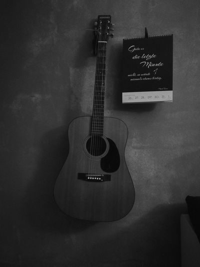 Music Indoors  Guitar Single Object Musical Instrument No People Classical Guitar Black & White Black And White Blackandwhite Musical Instrument String Music Home Interior Acoustic Guitar