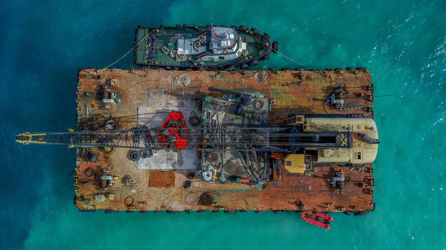 High angle view of rusty ship on sea
