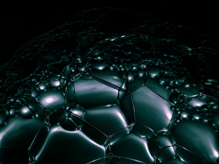 Close-up of bubbles over black background