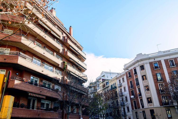 ordinary buildings at sunset Barcelona spain catalonia Building Exterior Architecture Built Structure Sky Residential District Low Angle View Building Nature City Window Day No People Outdoors Clear Sky Apartment Sunlight City Life Balcony Tree Row House