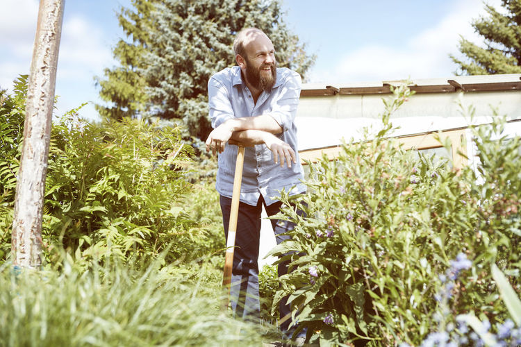 Full length of man standing in farm