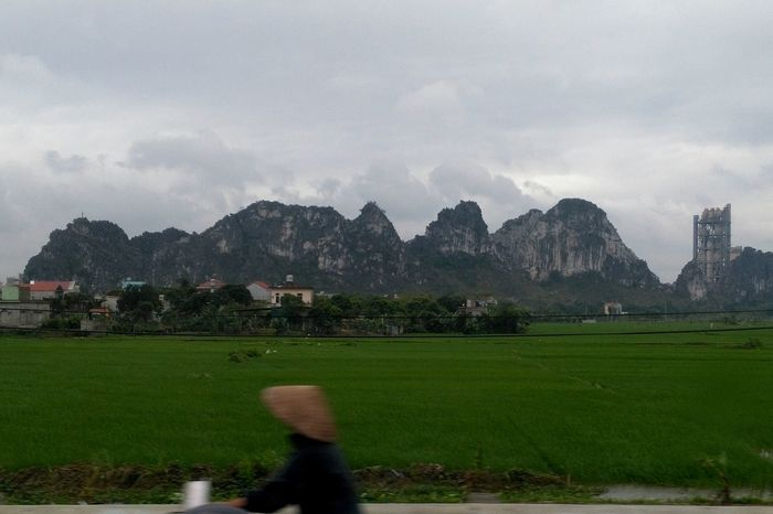 Touch to Hoa Lu Mountain One Person Leisure Activity Mountain Range Cloud - Sky Beauty In Nature Sky Traveling City Streets  Vietnam Travel Photography Vietnam Trip From My Window Cavescape Rice Farm Rice Fields. Long Goodbye