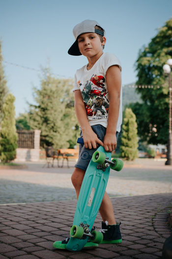 Summer holidays Childhood Full Length Child One Person Leisure Activity Day Real People Sports Equipment Casual Clothing Sport Lifestyles Boys Focus On Foreground Outdoors Skateboard Boy And Skate Boy In Hat Child Outdoor Summertime Holiday Fun Little Boy School Holidays