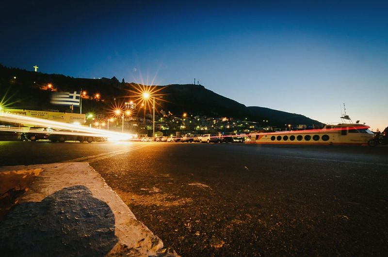 Illuminated street light against clear sky