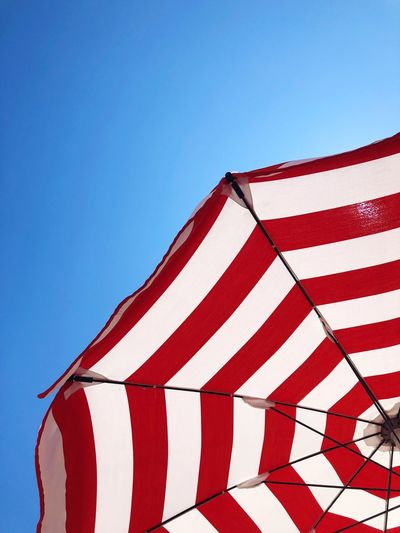Summer Sun Beach Blue Sky Red Striped Clear Sky Nature Flag Low Angle View Sunlight