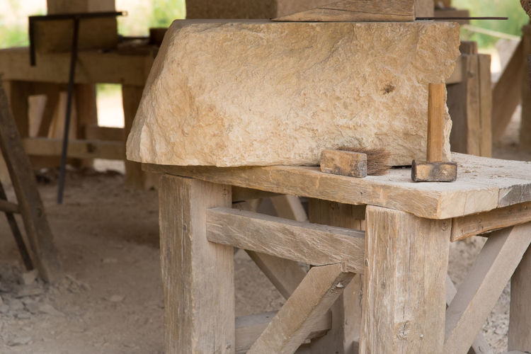 Architecture Close-up Craft Day Focus On Foreground Hammer Land Large Group Of Objects Log Nature No People Outdoors Seat Stone Cutting Stonecutter Stonemason Stonemason Art Stonemasonry Table Timber Tree Wood Wood - Material Work Tool Workshop
