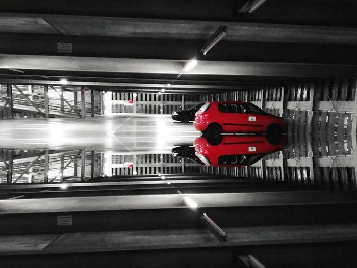 Red shopping cart in illuminated underground walkway