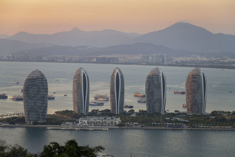 Aerial view of Sanya city and Dadonghai bay from Luhuitou Park in Hainan province, China Building Exterior Architecture Built Structure Sky City Water Mountain Cityscape cityscapes Travel Destinations Travel Photography Travel Hainan China Sanya Sanya.China Aerial View