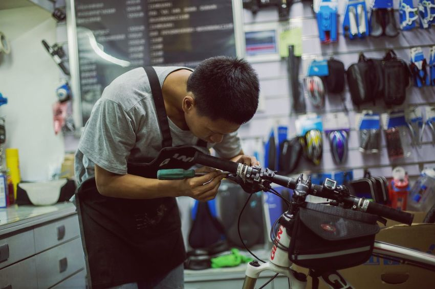 Indoors  Industry Real People Work Tool Business Finance And Industry Workshop Repairing Working Mechanic Occupation Men One Person Skill  Boys Technology Day Maintenance Engineer Adult People
