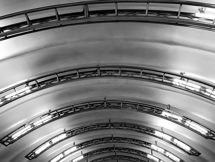 Russia Trip Blackandwhite Built Structure Architecture Low Angle View Indoors  No People Ceiling Day Building Pattern In A Row Architectural Feature Travel Destinations Railing Metal Modern Arch Architectural Column Concentric Ornate