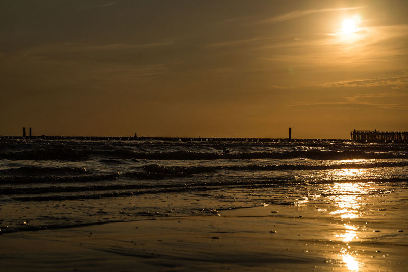 Westkapelle -Netherlands Beach Beauty In Nature Nature No People Outdoors Scenics Sea Silhouette Sky Sun Sunset Tranquility Water