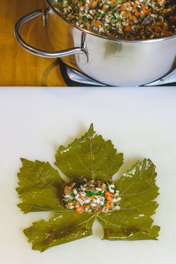 Close-up Cooking At Home Cypriot Food Day Food Food And Drink Freshness Green Color Healthy Eating Indoors  Leaf No People Ready-to-eat Stuffed Vine Leaves Table White Background