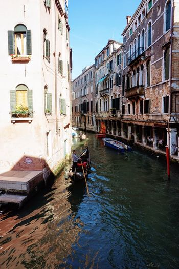 Architecture Building Exterior Canal Built Structure Transportation Travel Destinations Mode Of Transport Nautical Vessel House Day Water Waterfront Travel Window Travel Outdoors Gondola - Traditional Boat Clear Sky Scenic Venice Gondola Venice Italy Venice, Italy Venice Canals Venice View Sky