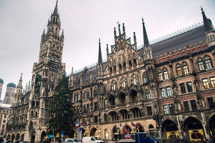 marienplatz main square of Munich germany, cloudy day Building Exterior Architecture Built Structure Travel Destinations Group Of People Building Travel Tourism Sky History The Past Crowd Large Group Of People City Real People Tower Women Day Men Outdoors Gothic Style Munich, Germany