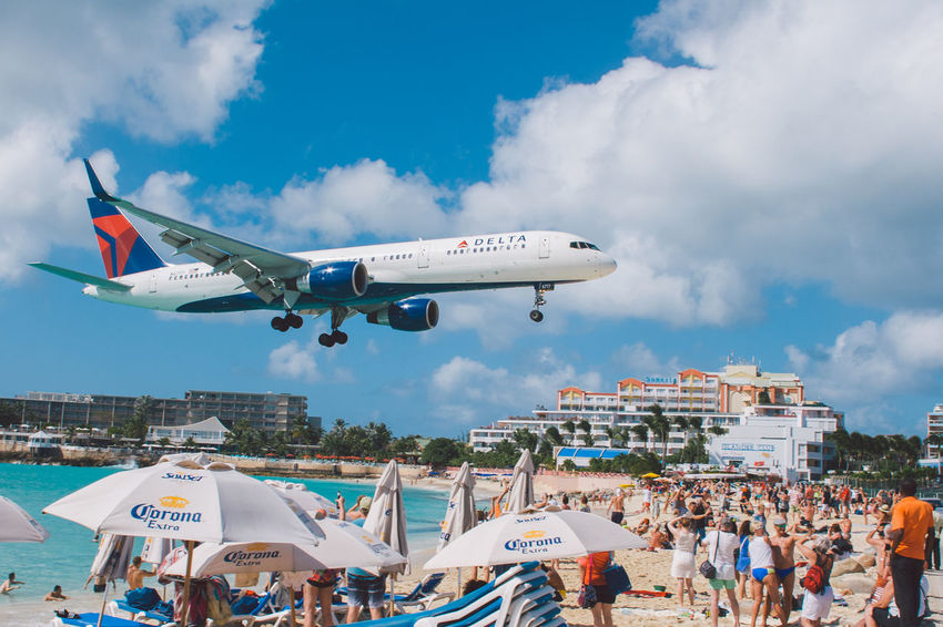 Maho Beach, St. Maarten Airplane Beach Fly Plane Vacations Airplane Beach Blue Caribbean Cloud - Sky Crowd Day Delta Delta Airlines Flying Large Group Of People Maho Beach Men Outdoors People Real People Sky St. Maarten Sunshine Travel Destinations Women