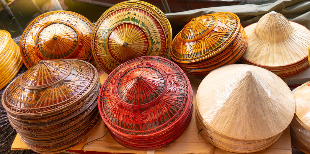 High angle view of hats for sale at market stall