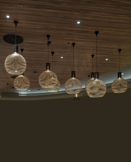interior modern light decoration brown tones and wooden theme Hanging Lighting Equipment Illuminated No People Indoors  Pendant Light Ceiling Light Low Angle View Electric Light Side By Side Decoration Electricity  In A Row Pattern Variation Arrangement Light - Natural Phenomenon Glowing Choice Electric Lamp Light Fixture