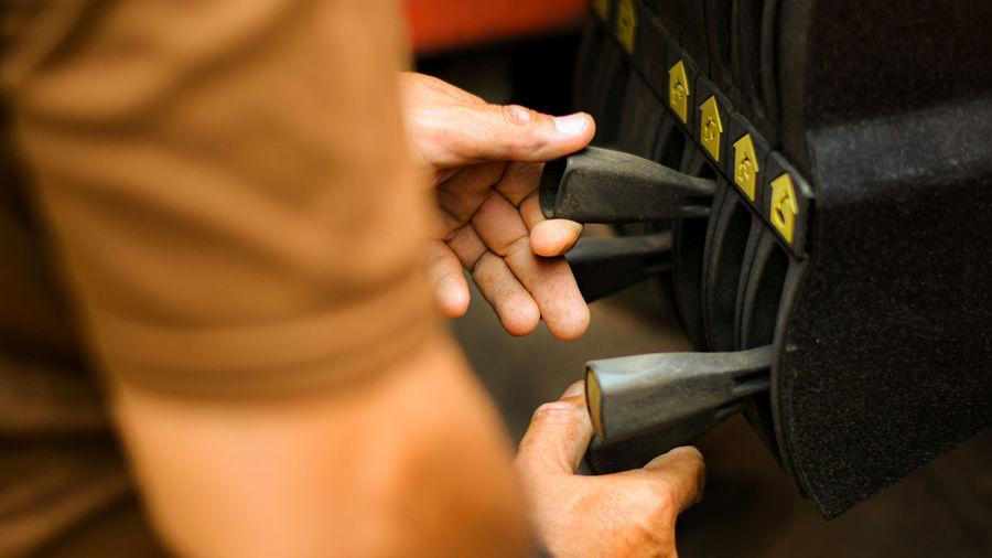 Close-up of man using machinery