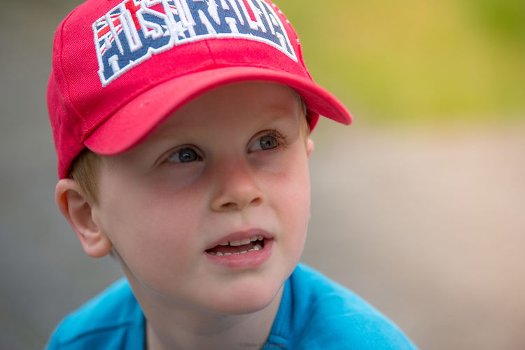 Close-up of thoughtful boy wearing red cap