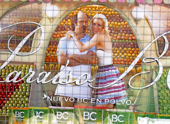 Street poster in Beunos Aires, Argentina Adult Adults Only Argentina Pic Beanos Aires Couple - Relationship Day Food Advertising Groceries Men Mid Adult Outdoors People Retail  Shopping Cart Smiling Store Street Posters Supermarket Togetherness Two People Women