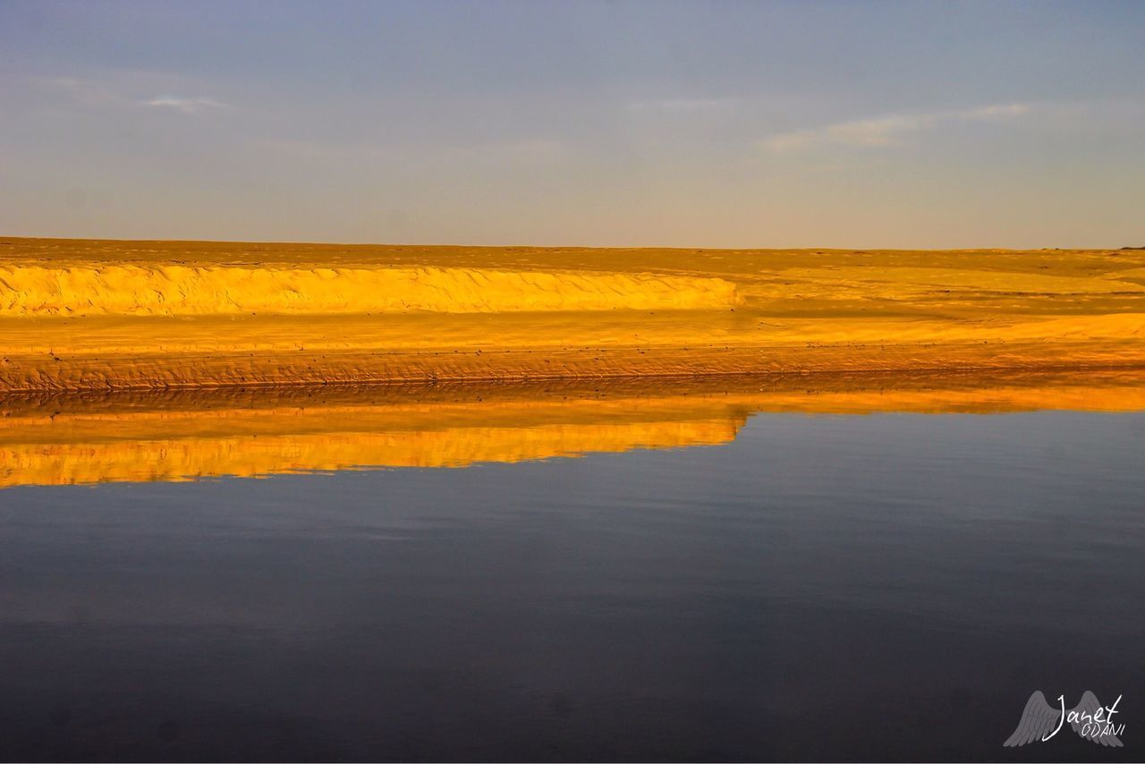 SCENIC VIEW OF TRANQUIL LANDSCAPE AGAINST SKY DURING SUNSET