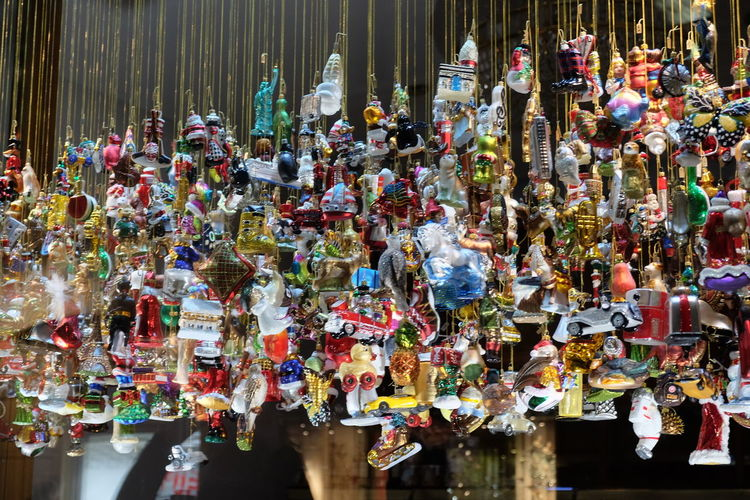 Various souvenir hanging for sale at market stall