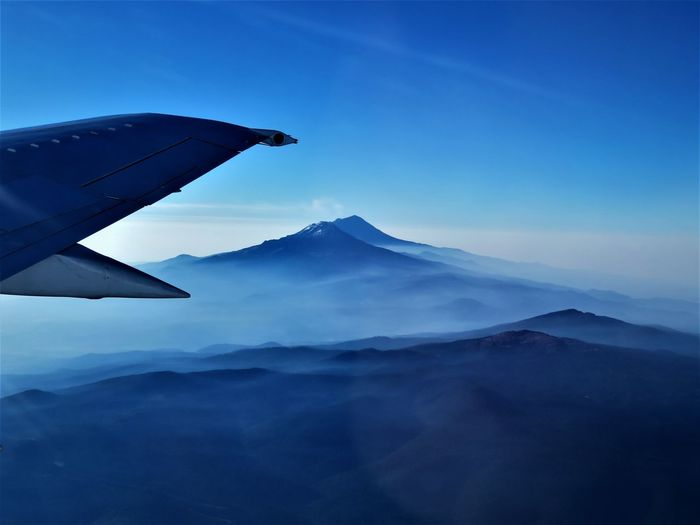 Aerial View Aircraft Wing Airplane Airplane Wing Beauty In Nature Blue Cloud - Sky Day Flying Landscape Mountain Mountain Peak Mountain Range Nature No People Outdoors Scenics Sky Travel Vulcan First Eyeem Photo This Is Latin America