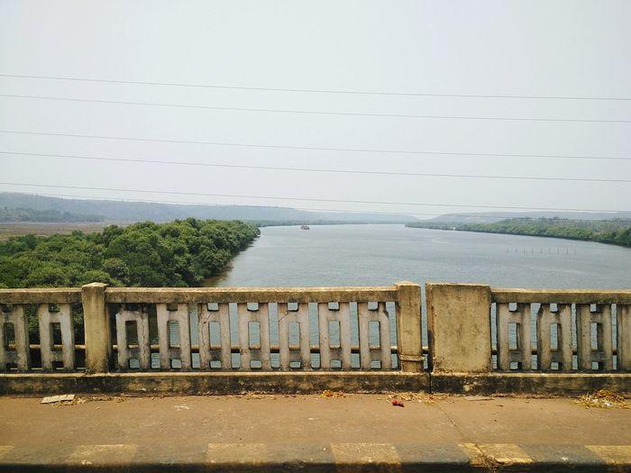 View from new Borim bridge over Zuari river in Goa. Borim Bridge Zuari Zuari River Goa Goa India Bridge View Scenery Greenery River Waterbody Travel Railing Goa Rivers Goan Roadway Waterway