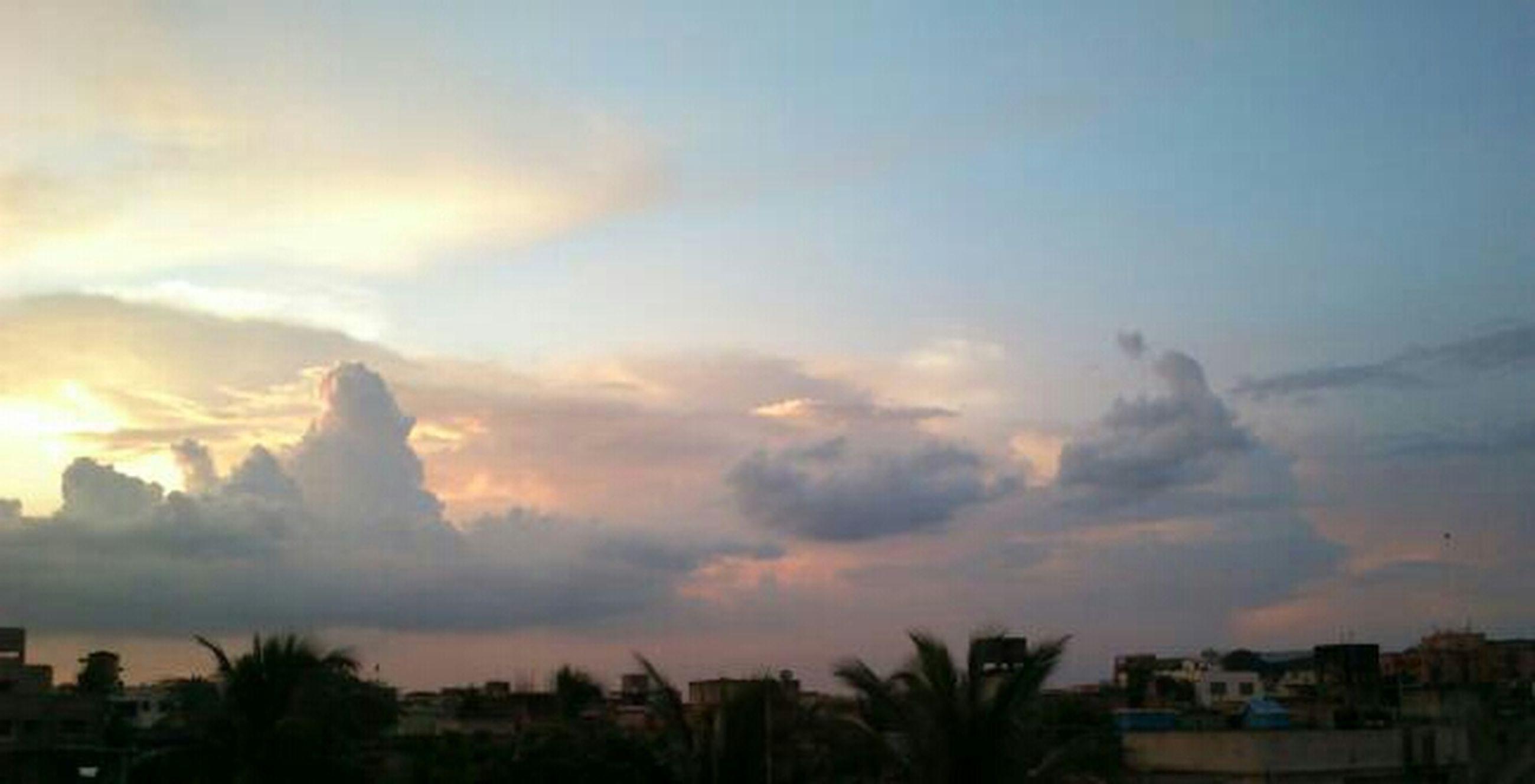 sunset, sky, building exterior, cloud - sky, architecture, built structure, scenics, beauty in nature, cloudy, nature, cloud, dusk, tranquil scene, tranquility, weather, tree, city, house, orange color, silhouette