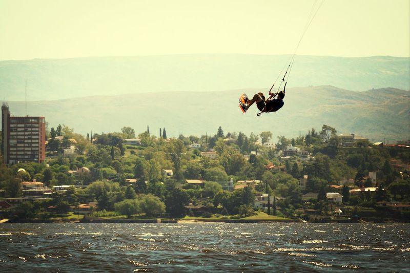 Kitesurfer flying above sea