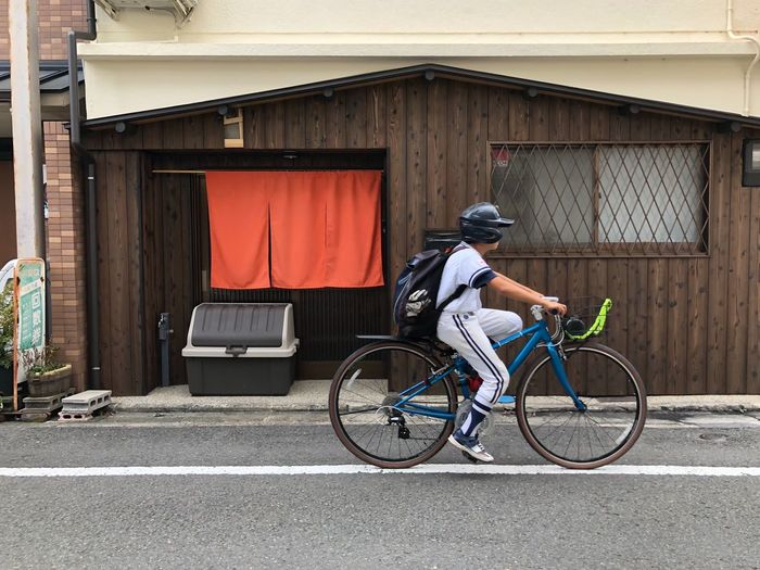 Off to Baseball training Bicycle Real People Baseball - Sport Side View One Person