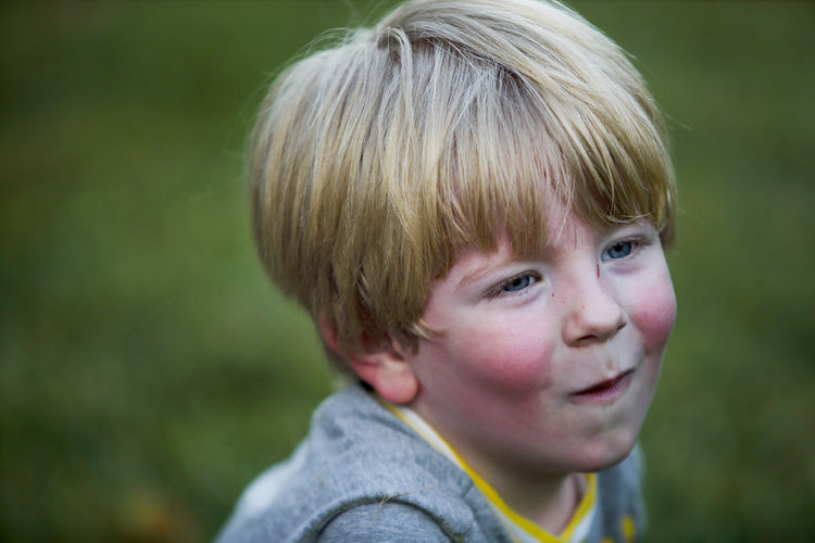 A three-year-old blonde hair blue eyed boy makes a funny face. Blond Hair Blue Eyes Boys Childhood Close-up Day Focus On Foreground Happiness Headshot Lifestyles One Person Outdoors Portrait Real People Rosy Cheeks