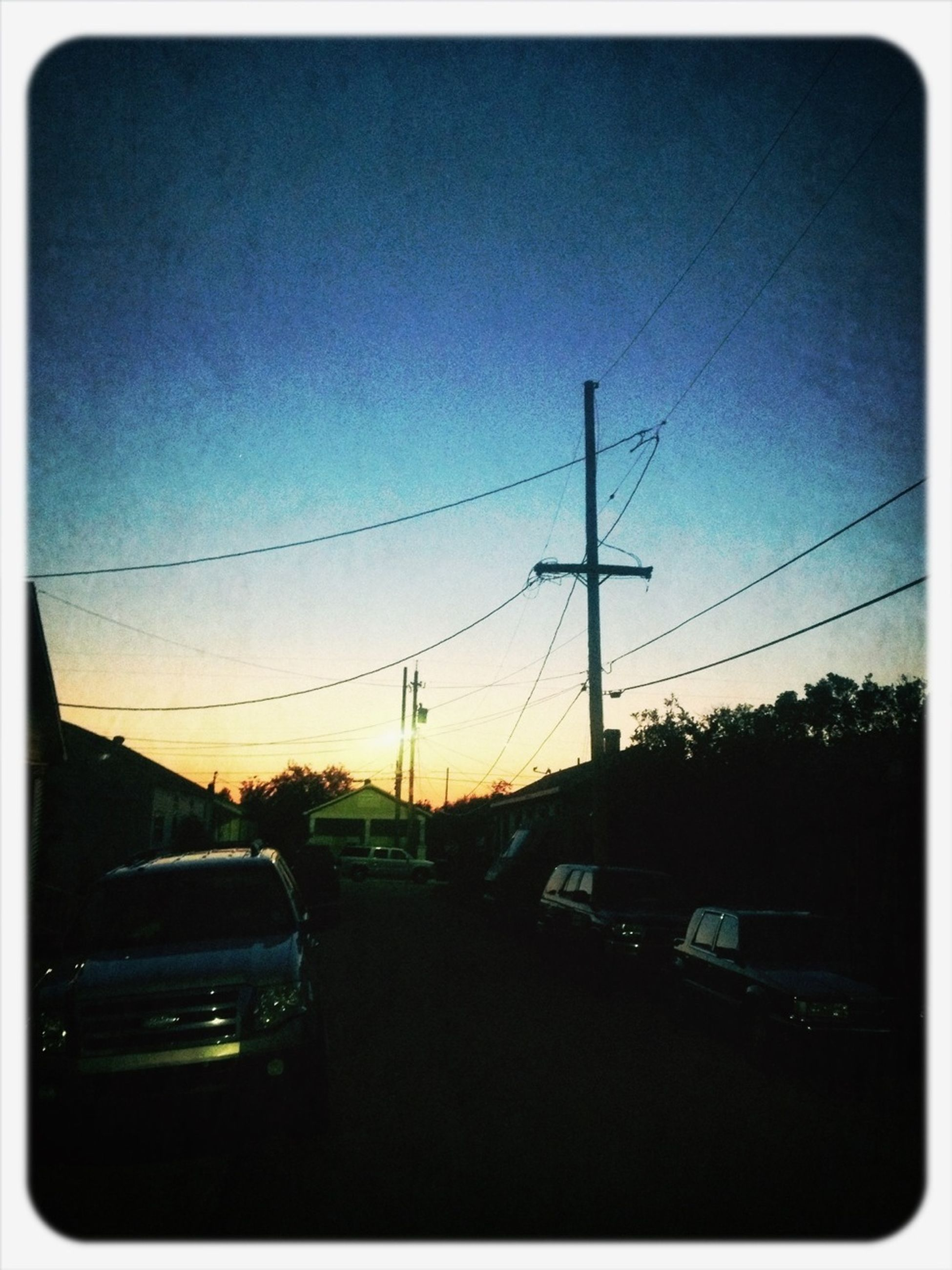 transportation, car, land vehicle, mode of transport, transfer print, sunset, road, sky, street, auto post production filter, silhouette, street light, power line, travel, on the move, electricity pylon, traffic, vehicle interior, clear sky, windshield